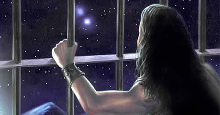 Imprisoned man staring out through barred window at stars.